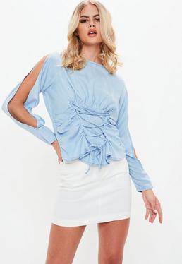 Camisa vaquera con mangas abiertas en azul