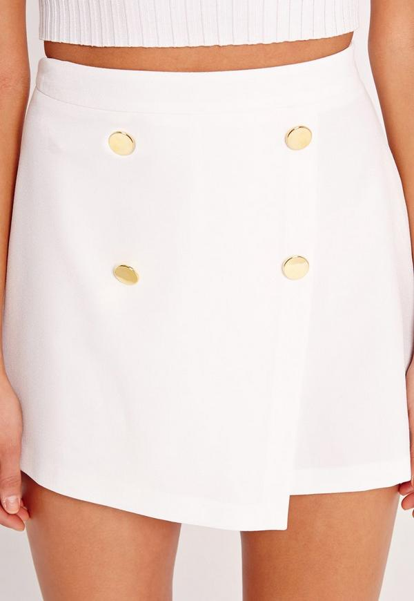 White cotton blend tailored shorts from Alice+Olivia featuring a waistband with belt loops, a concealed front fastening, back pockets and a short length. W, Login to see more detail. Login to see more detail. Read Review. 10% off for .