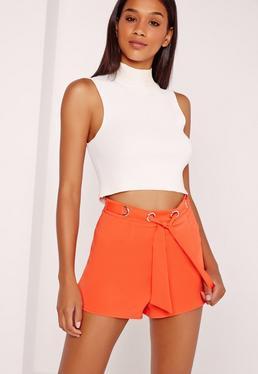 Short orange ceinture à nouer et passants métalliques