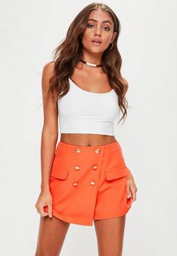 Pomarańczowe krótkie spódnico-spodenki z guzikami