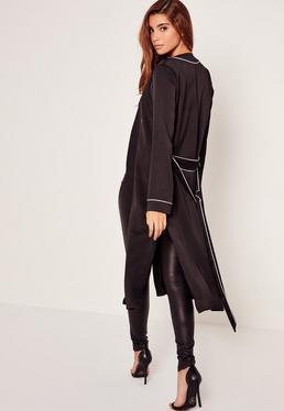 Blazer noir ceinturé à coutures contrastantes