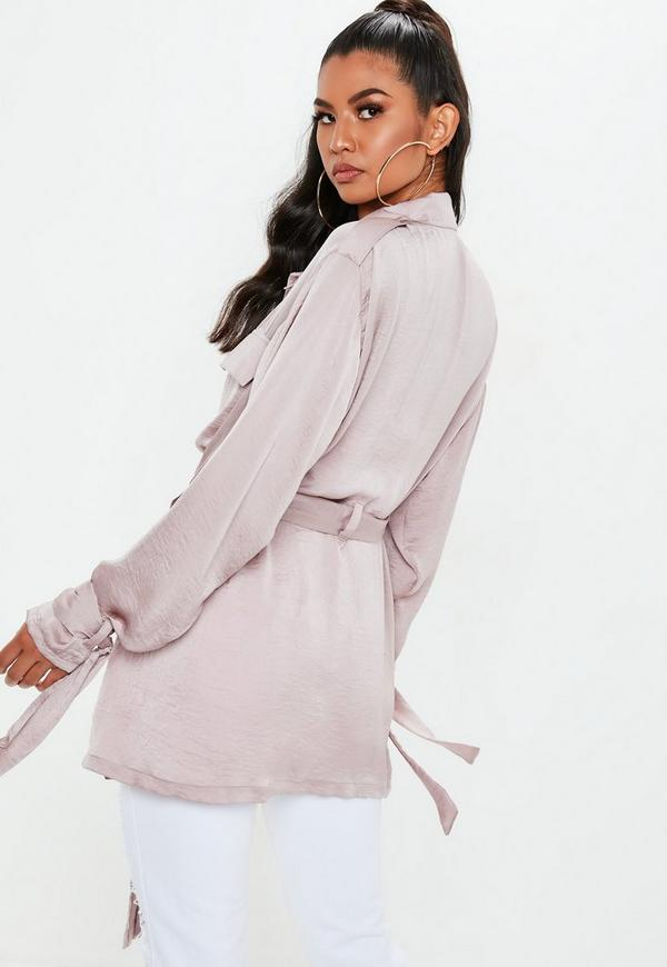 Based on vintage Korean souvenir jacket, this quilted satin jacket features knit cuffs and waist, a unique curved collar, side gussets and a completely customizable embroidered back design.