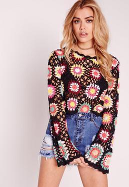 Pull noir en crochet à fleurs multicolores