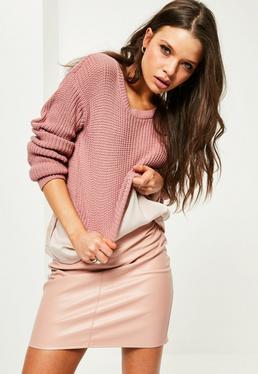 Różowy krótki sweterek z dzianiny