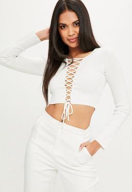 Biały sweter z wiązaniem na dekolcie