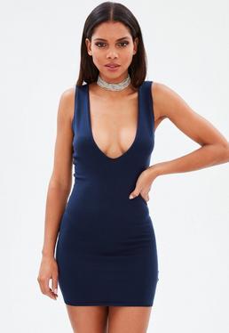 Vestido corto de punto con escote pronunciado en azul marino