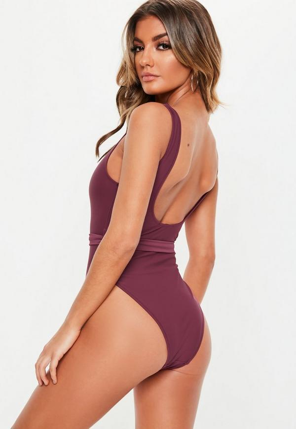 3d779bd743 ... Purple Buckle Waist High Leg Swimsuit. Previous Next