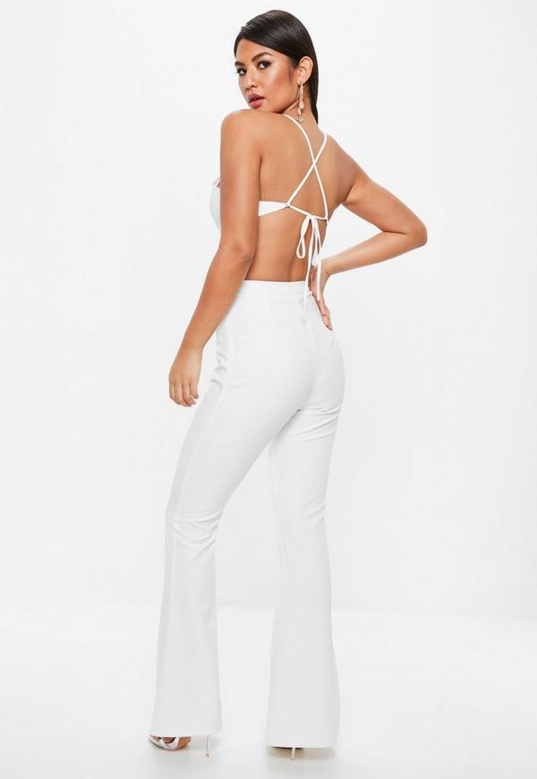 d31d4f2253bc White Strappy Cross Front Cut Out Flare Leg Jumpsuit. Previous Next