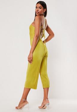 8fe94bf577e ... negro · Mono largo culotte plisado de tirantes en amarillo mostaza