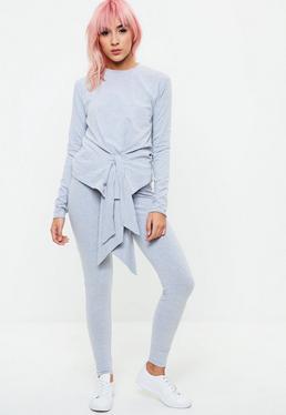 Conjunto camiseta manga larga con pantalón cruzados en gris