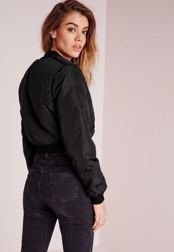A look for the bomber babe in all of us! Our Irreplaceable Bomber Jacket in Black features a cropped silhouette with stretch, banded hems and collar detail. Front zip and two side pockets with gold hardware. Get the look here and pair this trendy piece with a pop of sparkle in our Disco Ball Crop Top!