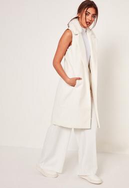 Manteau blanc sans manches col fausse fourrure