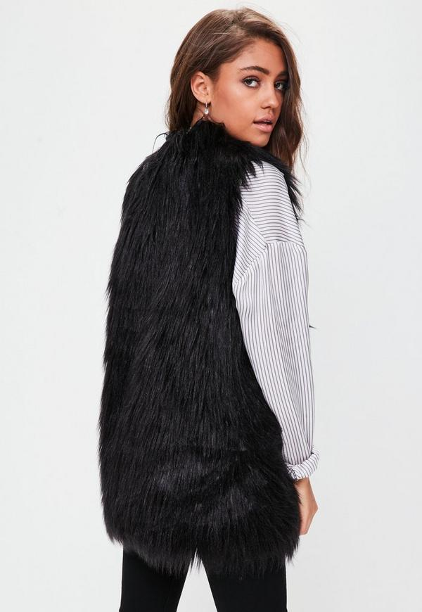 Black Faux Fur Pocket Hooded Vest - Women. A faux fur design creates a refined look and a luxurious feel. A flowing construction makes it ideal for layering. True to size % polyester Dry clean Imported. #NowTrending. 10 Faux Fur Coats To Cozy Up In This Fall.