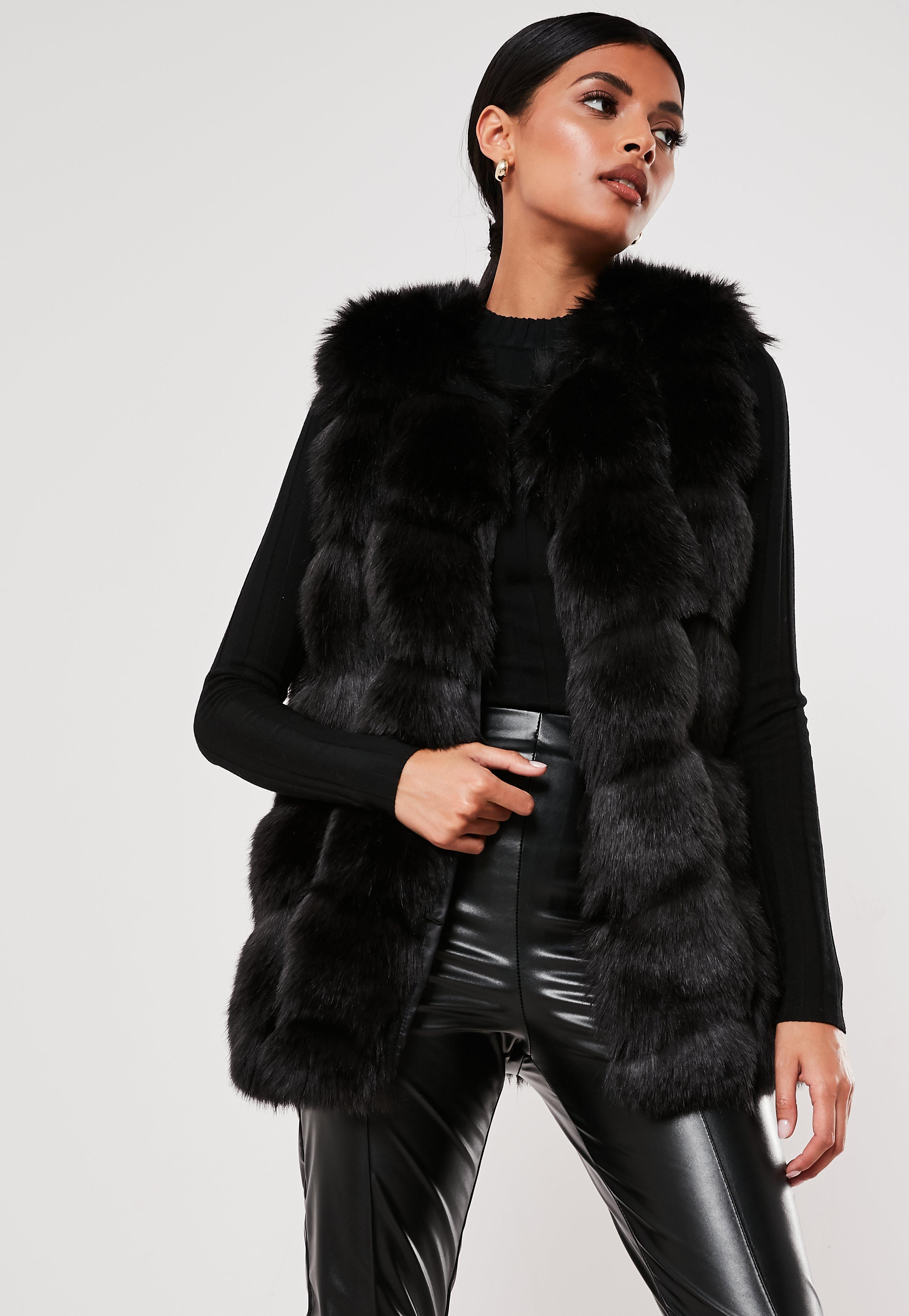 on feet images of reasonable price uk store Black Faux Fur Bubble Gilet | Missguided
