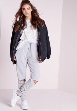Pantalón de chándal con rodillas rasgadas gris claro