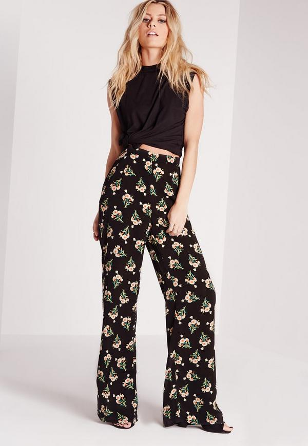 Exotic flowers grace the high waist Utopia Floral Print Wide Leg Pants to create a statement piece that's perfect for spring.