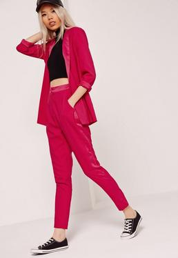 Pantalon cigarette rose vif à bandes soyeuses