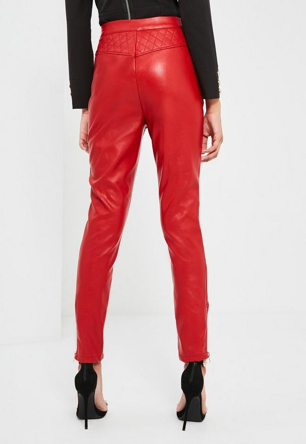 Red Leather (not faux) pants. Lined to knees in red acetate. very soft leather. Snap waist and zip front. Double pleats at waist. waist - 24