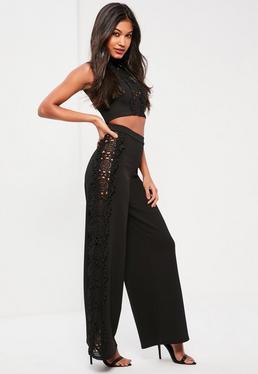 Czarne luźne spodnie z koronką po bokach