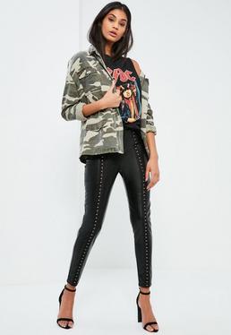 Legging noir en simili cuir détail agrafes devant