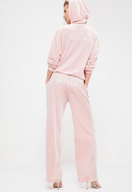 Różowe welurowe spodnie joggersy z napisem Galore
