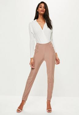 Różowe spodnie z pomarszczeniami