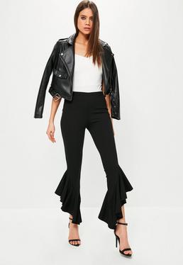 Czarne spodnie cygaretki z ozdobnymi falbanami