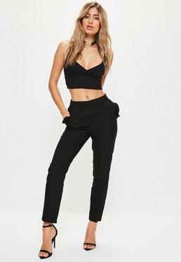 Pantalon cigarette noir en crêpe avec poches à froufrous