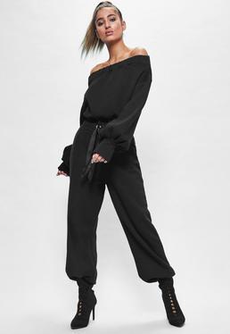 Czarne szerokie spodnie dresowe z ozdobnym logo Londunn + Missguided
