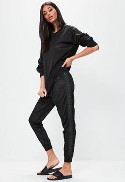 Czarne spodnie dresowe z siateczki Londunn + Missguided