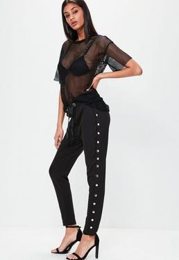 Czarne szerokie spodnie dresowe z ozdobnymi zapięciami po bokach Londunn + Missguided