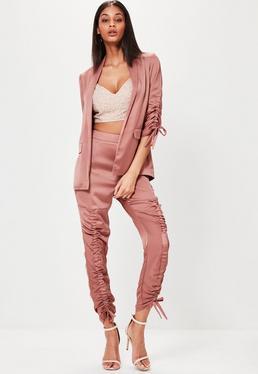Pantalón de pinzas acanalado en rosa dorado