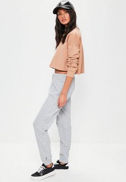 Szare spodnie dresowe z ozdobnym zamkiem po boku