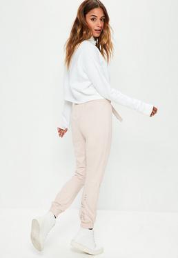 Różowe spodnie dresowe z ozdobnym nadrukiem As if