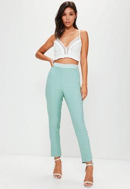 Niebieskie spodnie cygaretki z satynową wstawką