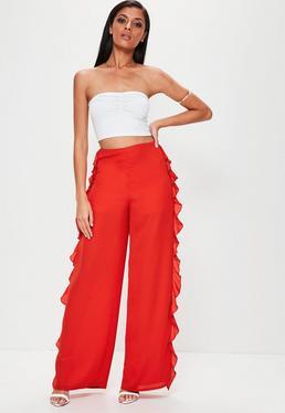 Czerwone szyfonowe spodnie z szerokimi nogawkami i falbankami po bokach