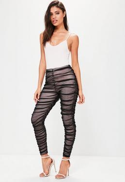 Czarne pomarszczone legginsy z ozdobną siateczką