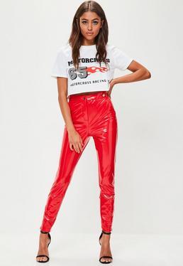 Pantalón pitillo tobillero de vinilo en rojo