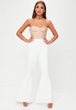 Białe tkane spodnie z rozszerzanymi nogawkami