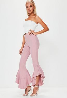 Ciemnoróżowe asymetryczne spodnie cygaretki z ozdobnymi falbanami
