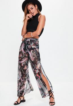 Pantalon transparent noir fendu à imprimé batik