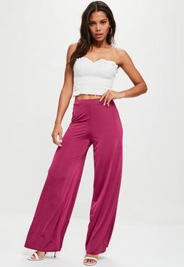 Pantalón brillante con pierna ancha en rosa