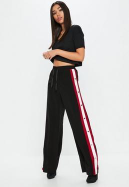 Czarne spodnie z zatrzaskami po bokach