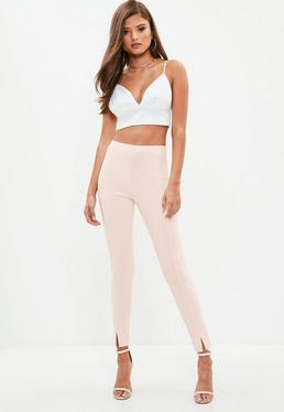 Różowe spodnie cygaretki z rozporkami