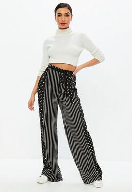 Czarne spodnie w kropki i paski