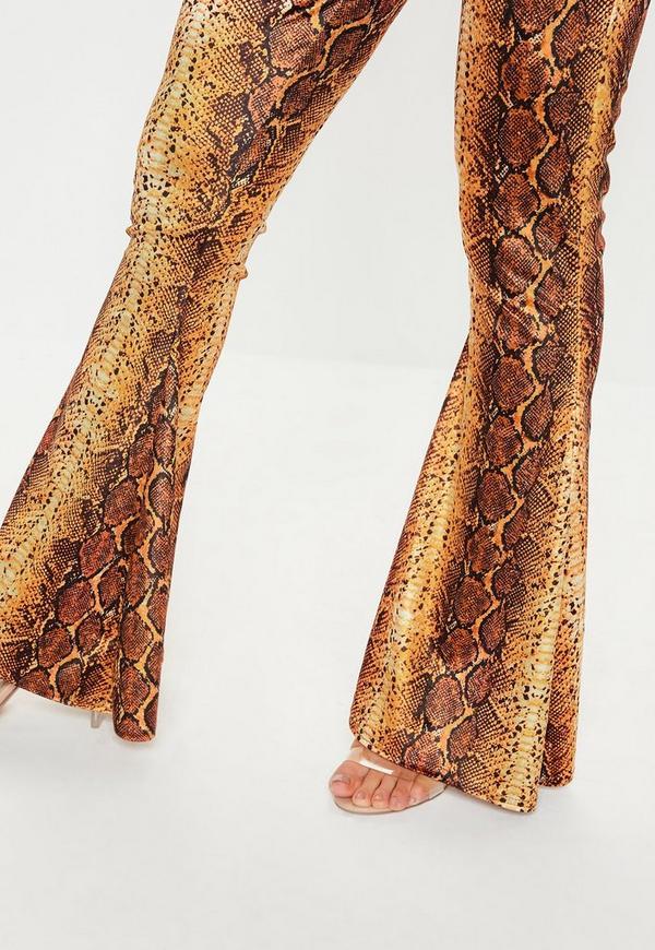 c5bba38d572 Orange Snake Print Velvet Flare Co Ord Trousers. Previous Next