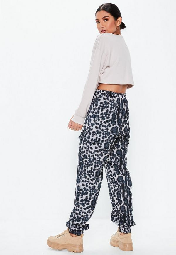 182f4fa51c199 Playboy X Missguided White Slogan Zip Front Ribbed Bodysuit. £22.00. BUY AT  MISSGUIDED · Blue Leopard Print Cargo Joggers by Missguided
