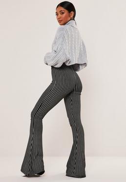 Расклешенные брюки с черной полосой