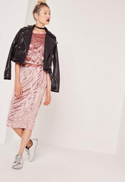 Falda midi plisada de terciopelo rosa
