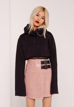 Różowa skórzana asymetryczna spódnica z klamrami